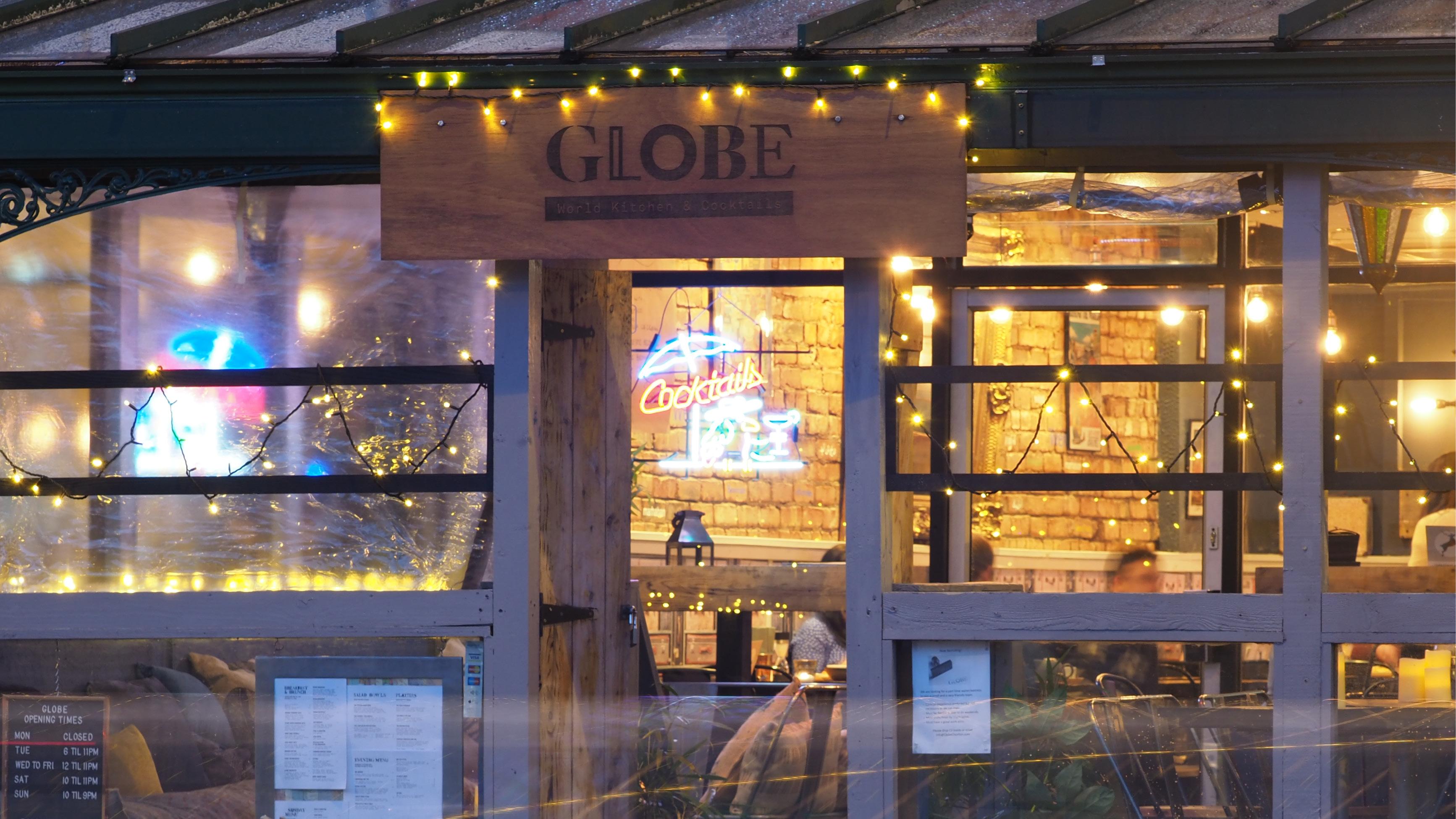 Globe sign over restaurant doorway