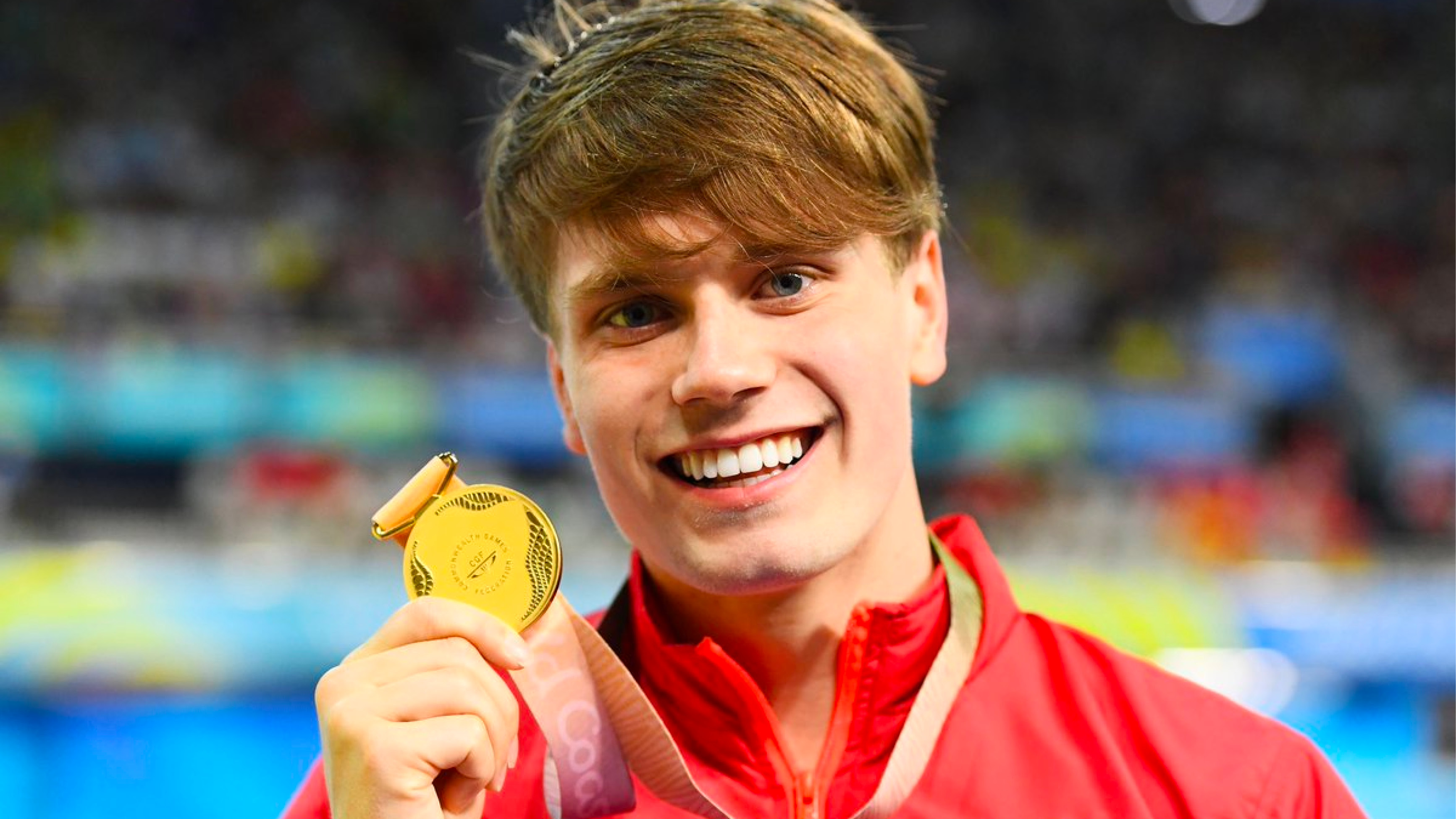 Tom Hamer holding medal